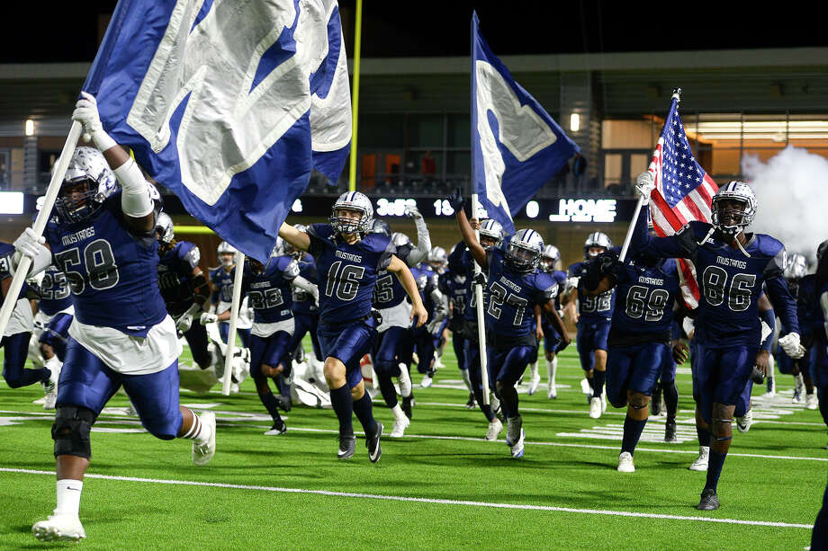 West Orange-Stark players run onto the field before the Mustangs play against Wimberley in the Class 4A Division 2 state semifinal game at Legacy Stadium in Katy on Friday night.  Photo taken Friday 12/15/17 Ryan Pelham/The Enterprise Photo: Ryan Pelham / ©2017 The Beaumont Enterprise/Ryan Pelham
