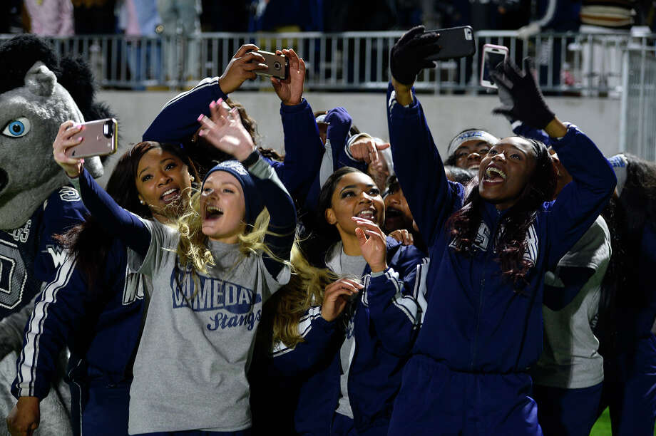 West Orange-Stark cheerleaders celebrate beating Wimberley in the Class 4A Division 2 state semifinal game at Legacy Stadium in Katy on Friday night.  Photo taken Friday 12/15/17 Ryan Pelham/The Enterprise Photo: Ryan Pelham / ©2017 The Beaumont Enterprise/Ryan Pelham