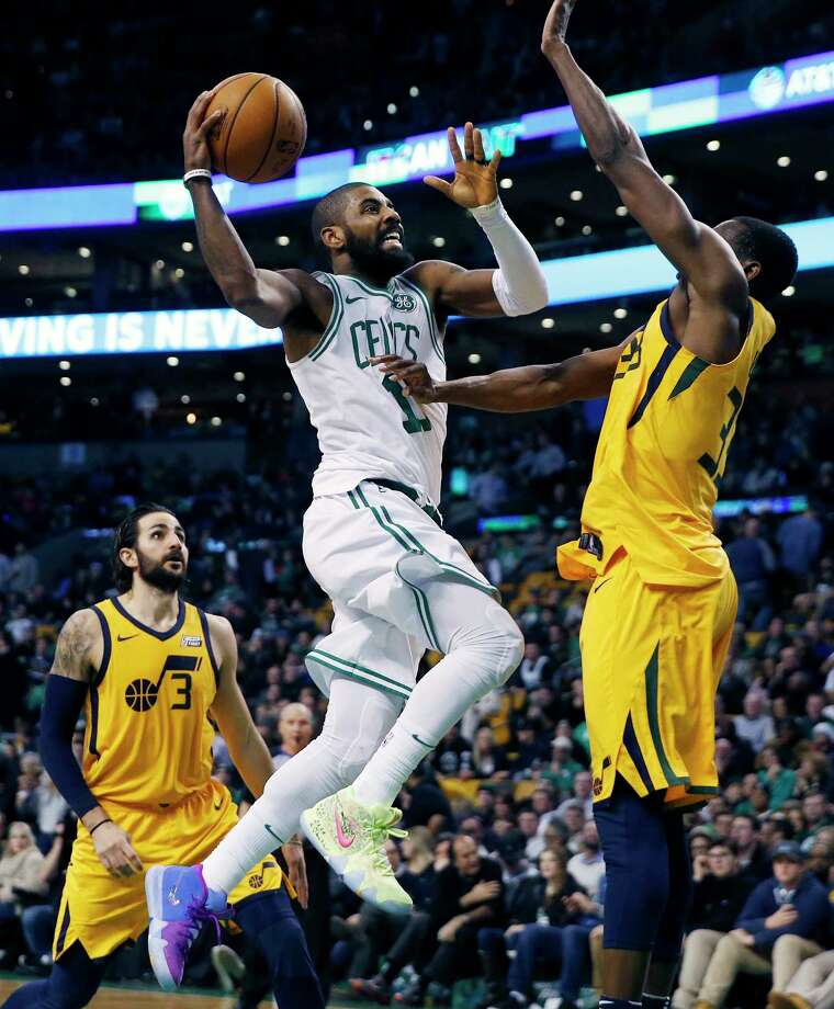 Boston Celtics' Kyrie Irving (11) goes up to shoot against Utah Jazz's Ekpe Udoh during the fourth quarter of an NBA basketball game in Boston, Friday, Dec. 15, 2017. The Jazz won 107-95. (AP Photo/Michael Dwyer) ORG XMIT: MAMD107 Photo: Michael Dwyer / AP2017