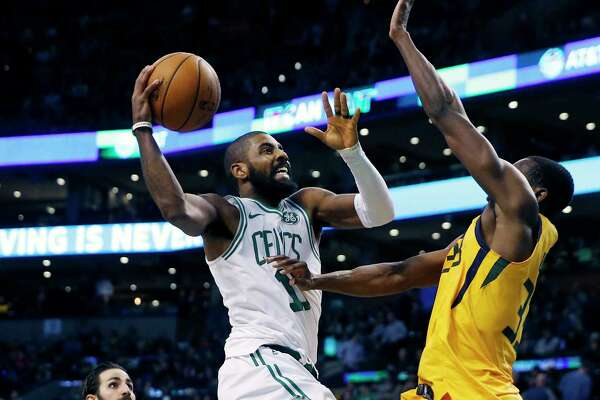 Boston Celtics' Kyrie Irving (11) goes up to shoot against Utah Jazz's Ekpe Udoh during the fourth quarter of an NBA basketball game in Boston, Friday, Dec. 15, 2017. The Jazz won 107-95. (AP Photo/Michael Dwyer) ORG XMIT: MAMD107