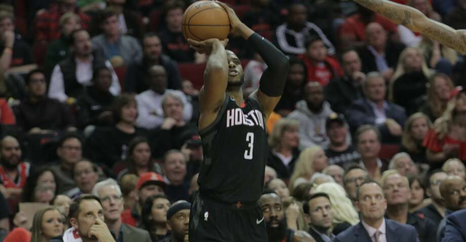 Houston Rockets guard Chris Paul (3) puts up three of his 28 points against the San Antonio Spurs at the Toyota Center on Friday, Dec. 15, 2017, in Houston. ( Elizabeth Conley / Houston Chronicle ) Photo: Elizabeth Conley/Houston Chronicle