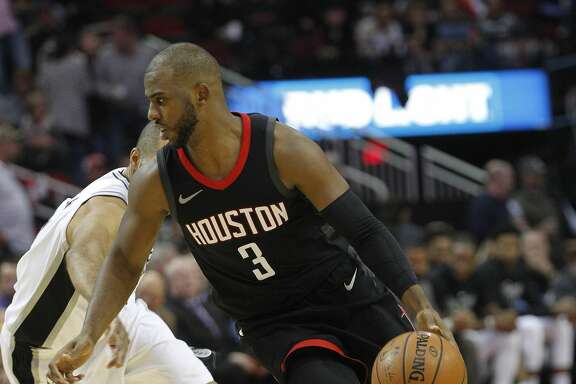 Houston Rockets guard Chris Paul (3) drives to the basket in the second half against the San Antonio Spurs at the Toyota Center on Friday, Dec. 15, 2017, in Houston. Rockets won the game 124-109. ( Elizabeth Conley / Houston Chronicle )