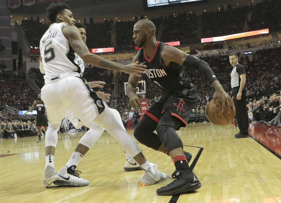 Houston Rockets guard Chris Paul (3) drives the ball against San Antonio Spurs guard Dejounte Murray (5) in the second half of game action at the Toyota Center on Friday, Dec. 15, 2017, in Houston. Rockets won the game 124-109. ( Elizabeth Conley / Houston Chronicle ) Photo: Elizabeth Conley/Houston Chronicle