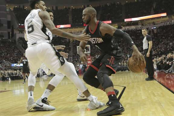 Houston Rockets guard Chris Paul (3) drives the ball against San Antonio Spurs guard Dejounte Murray (5) in the second half of game action at the Toyota Center on Friday, Dec. 15, 2017, in Houston. Rockets won the game 124-109. ( Elizabeth Conley / Houston Chronicle )