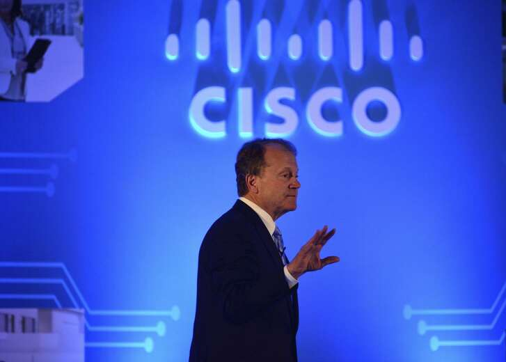 """John Chambers, shown speaking in New Delhi in 2015, says his next area of passion will be """"startup coun tries."""" Chambers, who stepped down as CEO of Cisco Systems in 2015, retired as its chairman Monday."""