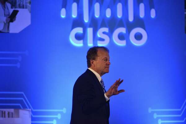 "John Chambers, shown speaking in New Delhi in 2015, says his next area of passion will be ""startup coun tries."" Chambers, who stepped down as CEO of Cisco Systems in 2015, retired as its chairman Monday."