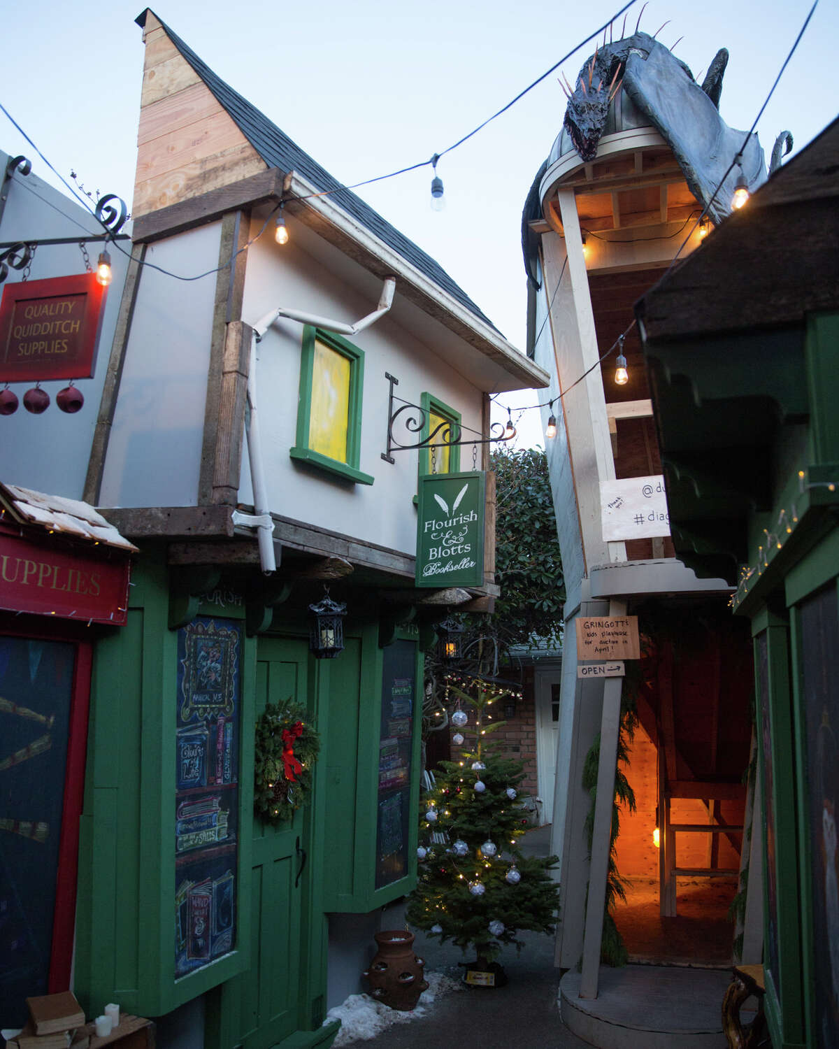 The now-famed recreation of Diagon Alley, a shopping street location from the Harry Potter books, at a home in Ballard is turned Christmas-themed, seen on Thursday, Dec. 13, 2017.