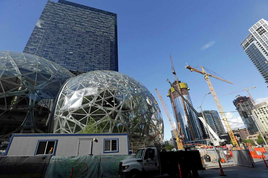 Large spheres take shape in front of an Amazon building, behind, as construction continues across the street. Seattle is among the cities that have flourished since the Great Recession officially began in December 2007. But many U.S. areas have managed only modest recoveries. Photo: Elaine Thompson, STF / Copyright 2017 The Associated Press. All rights reserved.