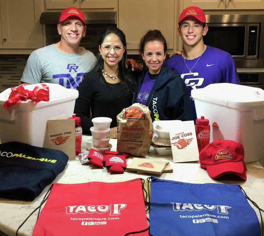 The Coss family received food and merchandise from Taco Palenque after discussing how much they missed their favorite hometown food in LMT last week. Former Alexander quarterback Ezekiel Coss and coach Joe Coss moved to Round Rock two years ago, and the duo now have Cedar Ridge in the final four of the Texas 6A state playoffs. Pictured are Joe Coss, cousin Beckie Palomo, Joe's wife Ronnie and Ezekiel Coss. Photo: Courtesy Photo