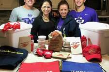 The Coss family received food and merchandise from Taco Palenque after discussing how much they missed their favorite hometown food in LMT last week. Former Alexander quarterback Ezekiel Coss and coach Joe Coss moved to Round Rock two years ago, and the duo now have Cedar Ridge in the final four of the Texas 6A state playoffs. Pictured are Joe Coss, cousin Beckie Palomo, Joe's wife Ronnie and Ezekiel Coss.