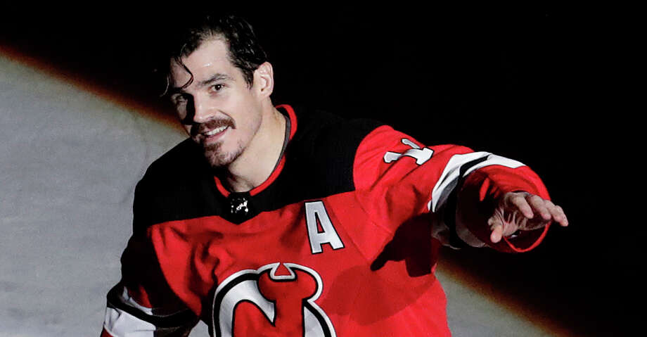 New Jersey Devils center Brian Boyle (11) takes a curtain call after his two goals helped his team win over the Dallas Stars in an NHL hockey game, Friday, Dec. 15, 2017, in Newark, N.J. (AP Photo/Julio Cortez) Photo: Julio Cortez/Associated Press