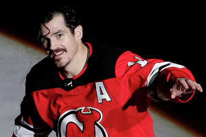 New Jersey Devils center Brian Boyle (11) takes a curtain call after his two goals helped his team win over the Dallas Stars in an NHL hockey game, Friday, Dec. 15, 2017, in Newark, N.J. (AP Photo/Julio Cortez)