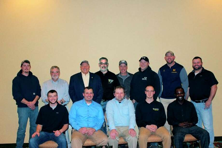 Three Rivers Corp. honored 13 employees in six categories at an awards banquet Dec. 4. Back row, from left : Casey Grove, Jeff Hammond, Wayne Sczepanski, Joe Hauri, Kurt Fletcher, Chad Kolba, Troy Sullivan and Eric Biskner.Frontrow, from left: Travis Gray, Jeremiah Crivac, Eric Barber, Joel Kennedy and Sore Stanley.