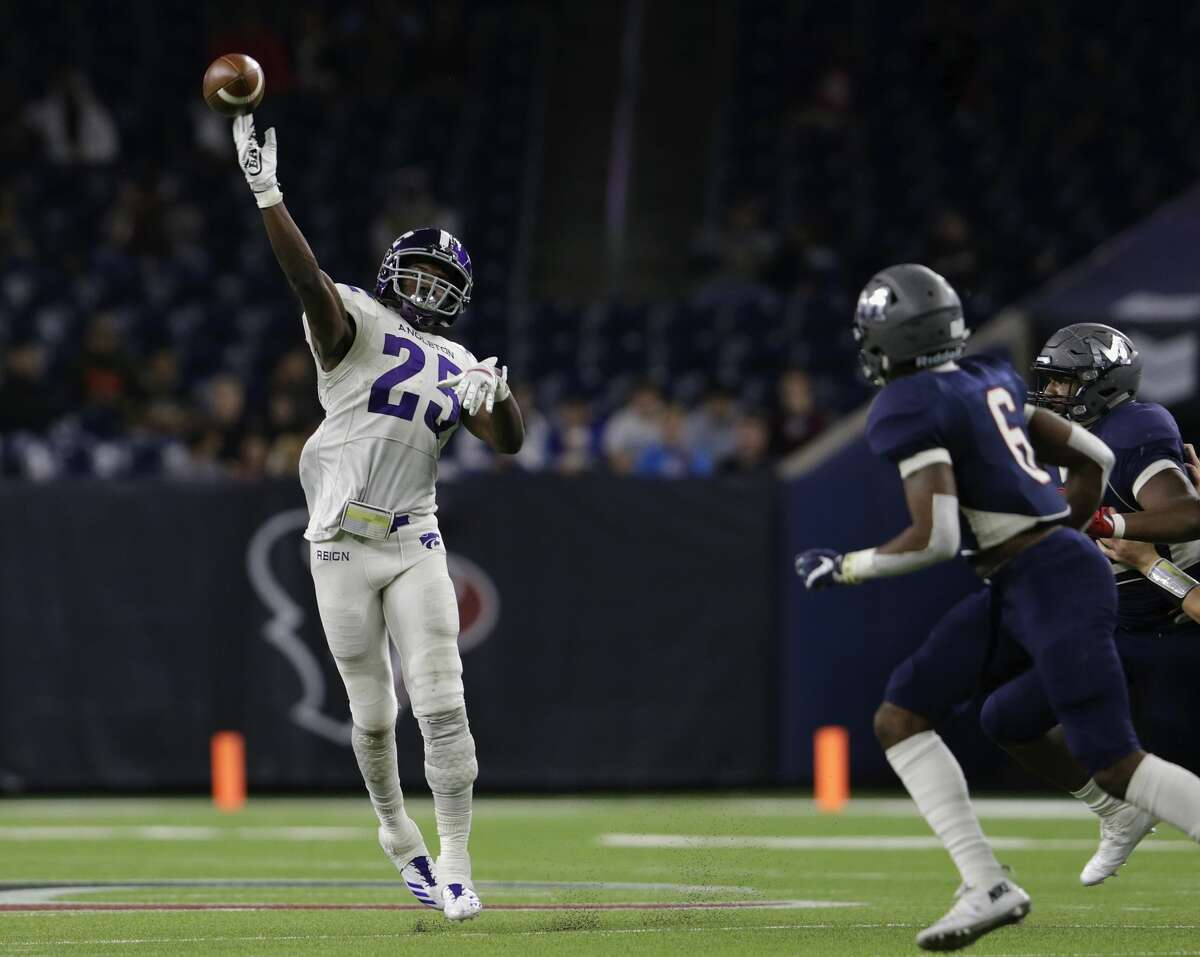 Angleton Wildcats free safety B.j. Foster (25) throws a pass in the fourth quarter defended by Manvel Mavericks linebacker Brian Johnson (6) during the high school football semifinal playoff playoff game between the Manvel Mavericks and the Angleton Wildcats at NRG Stadium in Houston, TX on Friday, December 15, 2017.