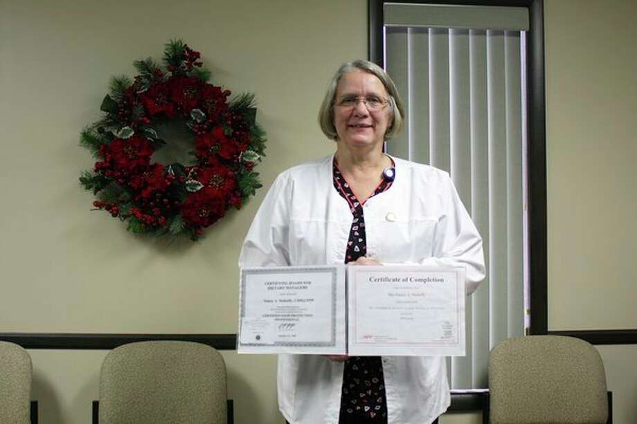 Marlette Regional Hospital's nutritional services department employee Nancy Mahaffy, CDM, CFPP displays a certificate of completion for the ANFP's new continuing education course. (Submitted photo)