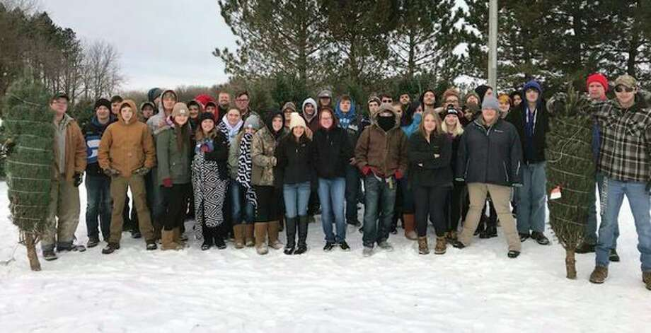 Ascent High School went to Cook's Tree Sales this week. Ascent purchases one tree for the schooland then Hilary Cook, owner of the tree farm, donates another to the schoolso studentscan deliver it to a family in need of a Christmas tree in the Bad Axe area. (Submitted Photo)