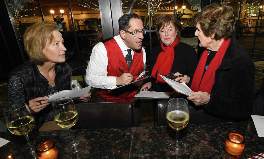 From left, Judges Joanne Parsons of Trumbull, Frank Gaffney of Norwalk, Meg Finnerod of Old Greenwich and Marion Glowka of Stamford have a group discussion as they tally up their scores following a walking tour to review the entries in the eighth annual Holiday Window Salute in Stamford (Conn.) Downtown on Dec. 14, 2017. Photo: Matthew Brown / Hearst Connecticut Media / Stamford Advocate