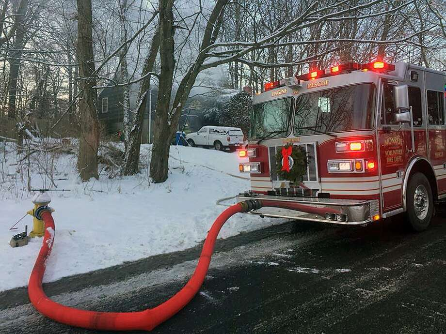 The Monroe Fire Department responded to Osborne Lane on Saturday, Dec. 16, 2017, for smoke coming from a residence. While en route, firefighters received an additional call about a structure fire just down the road. Both fires were extinguished and no injuries were reported. Photo: Contributed Photo / Monroe Fire Department / Contributed Photo / Connecticut Post Contributed