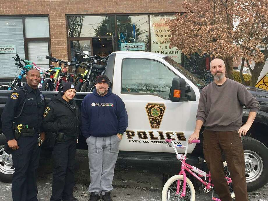 Norwalk, Conn., police Lt. Terry Blake said community police officers helped Alex Stanek, the owner of Smart Cycles, deliver bicycles to the Human Services Council on Friday, Dec. 15, 2017. Photo: Contributed Photo / Norwalk Police Department / Contributed Photo / Connecticut Post Contributed