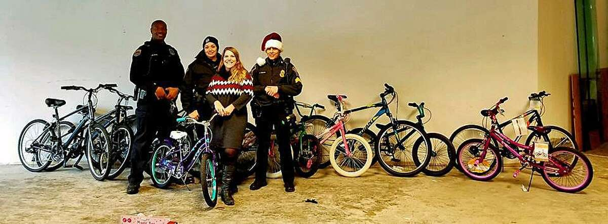 Norwalk, Conn., police Lt. Terry Blake said community police officers helped Alex Stanek, the owner of Smart Cycles, deliver bicycles to the Human Services Council on Friday, Dec. 15, 2017.