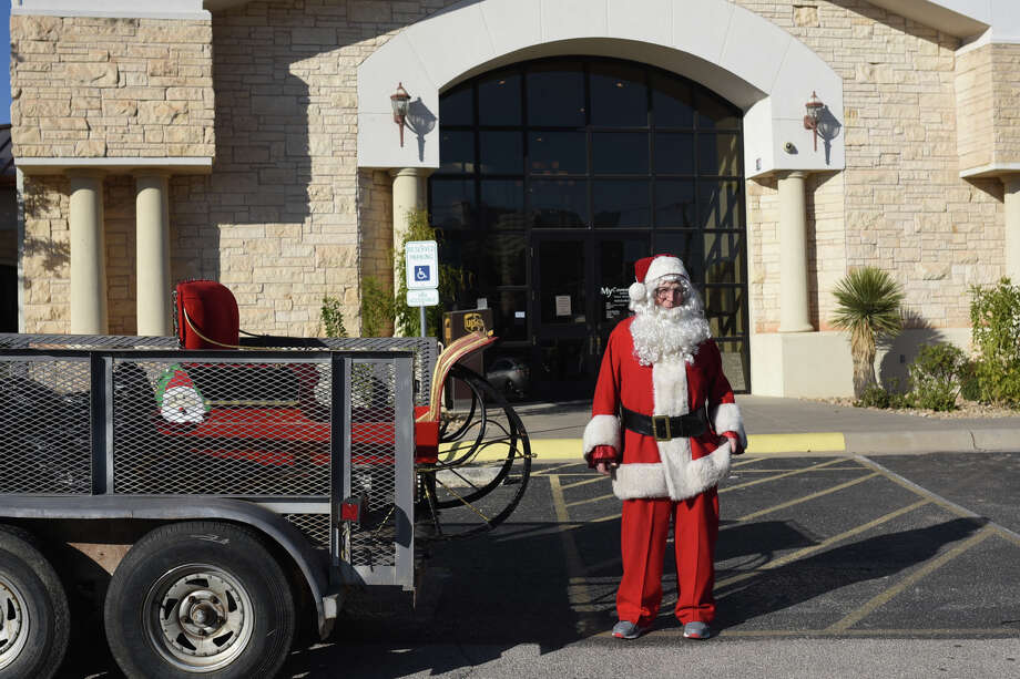Vic Brenon, who volunteers as Santa during the holiday season collects toys to distribute in the community, Dec. 15, 2017, at My Community Credit Union. James Durbin/Reporter-Telegram Photo: James Durbin
