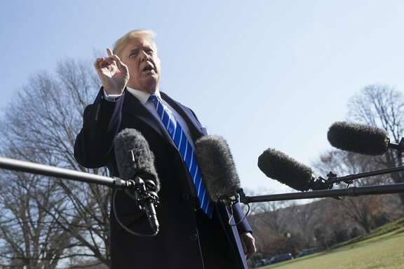 U.S. President Donald Trump speaks to members of the media before departing for Camp David on the South Lawn of the White House in Washington, D.C., U.S., on Saturday, Dec. 16, 2017. Trump�had initially called for a top rate around 10 percent for companies' offshore profits, but as GOP lawmakers searched for revenue to offset the cost of other tax cuts, one of the sources they settled on was multinationals' offshore cash. Photographer: Chris Kleponis/Bloomberg