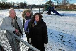 Neighborhood activists Andrew Strauss, Ernie Grevers and Laurie Mirra from South Norwalk and Village Creek describe their plan to beautify Woodward Avenue Park Thursday, December 14, 2017, at the park in Norwalk, Conn. The completed improvements include the addition of new trees and shrubs including dogwoods, lilacs, honey locust, mountain laurel, holly and inkberry, but have not yet received any grants or Recreation and Parks budget to help execute the rest of their plan.