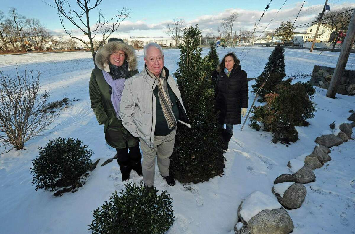 Neighborhood activists Ernie Grevers, Andrew Strauss and Laurie Mirra from South Norwalk and Village Creek describe their plan to beautify Woodward Avenue Park Thursday, December 14, 2017, at the park in Norwalk, Conn. The completed improvements include the addition of new trees and shrubs including dogwoods, lilacs, honey locust, mountain laurel, holly and inkberry, but have not yet received any grants or Recreation and Parks budget to help execute the rest of their plan.