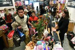 Holiday shoppers shop for gifts in Lush at Crossgates Mall on Black Friday Nov. 24, 2017 in Guilderland, N.Y. (Lori Van Buren / Times Union)