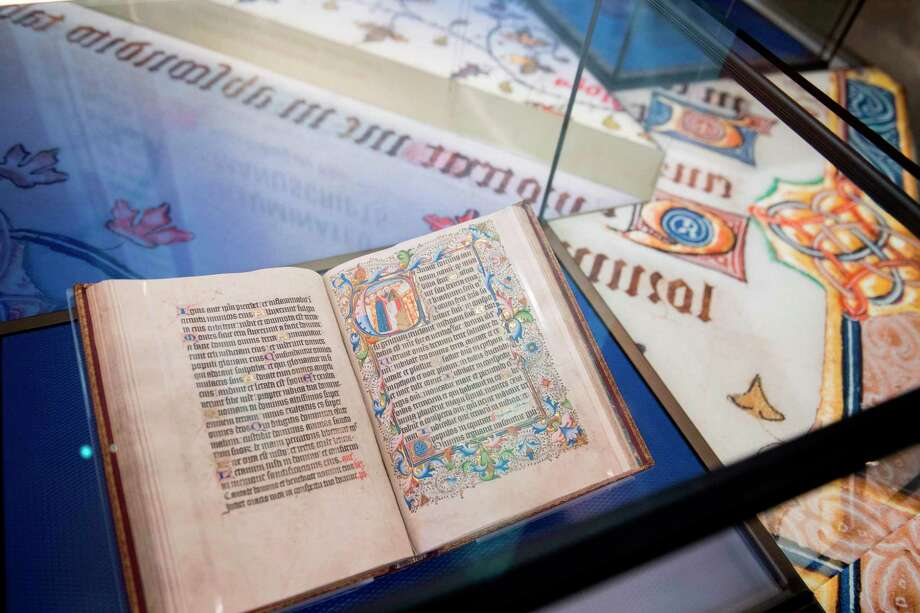 A bible is seen in the History of the Bible exhibit during a media preview of the new Museum of the Bible, a museum dedicated to the history, narrative and impact of the Bible, in Washington, DC, November 14, 2017. / AFP PHOTO / SAUL LOEBSAUL LOEB/AFP/Getty Images Photo: SAUL LOEB, Contributor / AFP or licensors