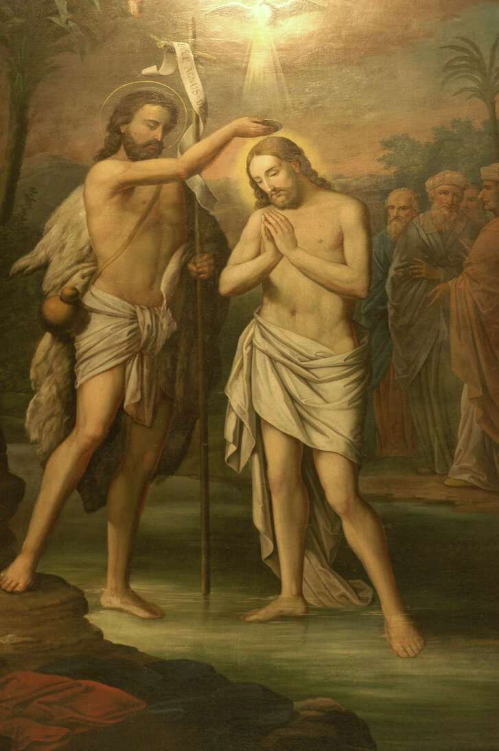 Detail shot of St. John the Baptist baptizing Jesus on display at St. John Cathoilic Church in Fayettevill. Scholars and theologians have debated about just how dark Jesus of Nazareth's skin was.  (E. Joe Deering/Chronicle).