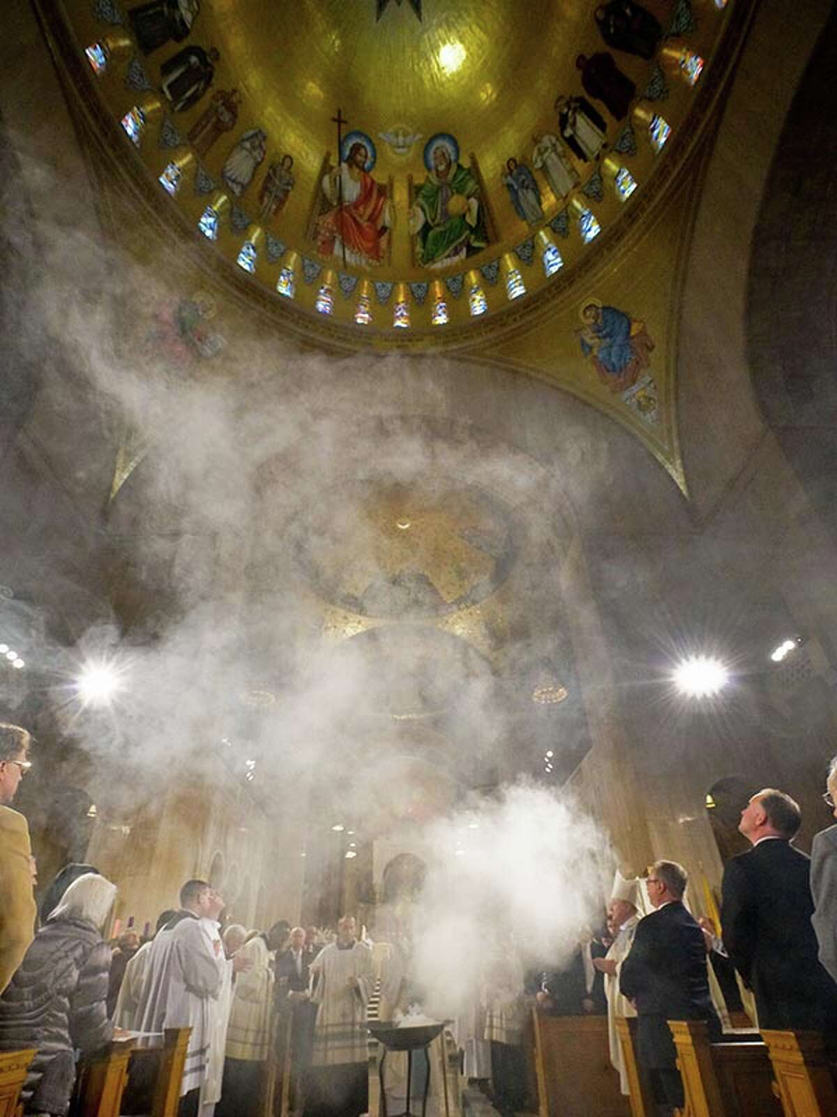 """Incense rises to bless the """"Trinity Dome"""" during the dedication of the Basilica of the National Shrine of the Immaculate Conception in Washington, D.C."""