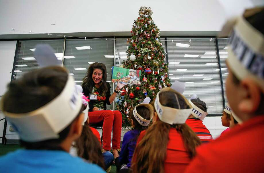 Lieder Elementary Principal Karen Stockton reads a Christmas story to first-graders in the Cy-Fair school's library. The Merry Christmas Texas Project works to educate school officials and parents about the legal right to put up Christian-themed decorations in public schools. Photo: Michael Ciaglo, Houston Chronicle / Michael Ciaglo