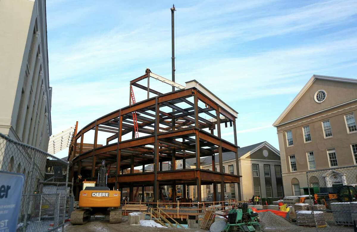 The final steel beam for the new Integrated Science and Engineering Complex at Union College on placed into position on Friday morning, Dec. 15, 2017, at Union College in Schenectady, N.Y. The $100 million project will be completed in phases over the next two years. This includes an addition completed for fall term 2018 and renovation of three sections of the existing S&E Center by fall 2019. (Matt Milless/Union College)