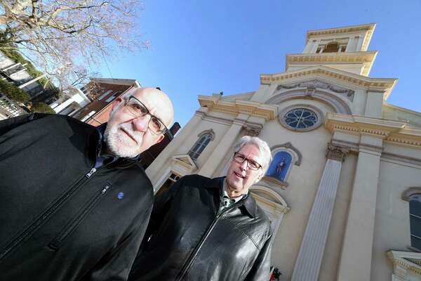 Frank Carrano, left, and Steve Hamm photographed in front of St. Michael Roman Catholic Church on Wooster Square in New Haven. Carrano is a subject in a documentary Hamm is making about the history of Wooster Square.