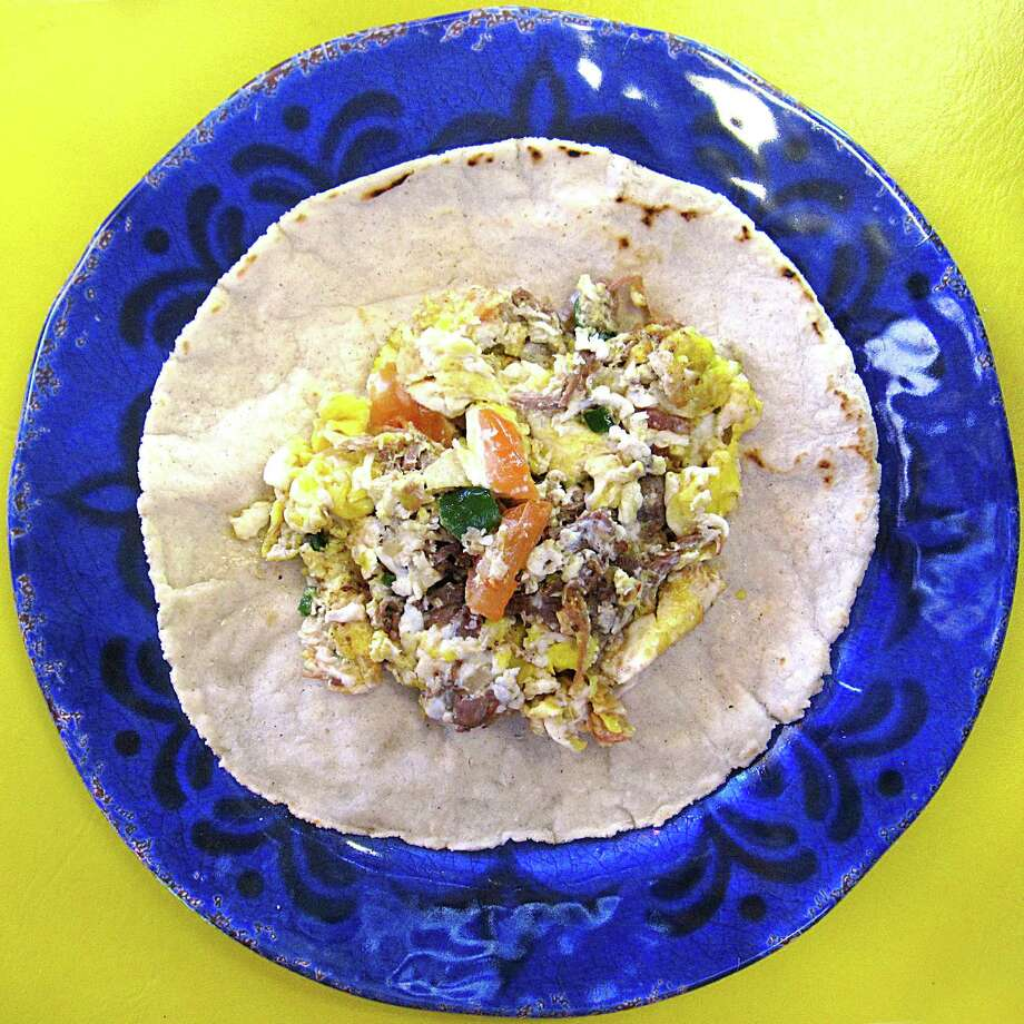 Machacado taco with eggs and pico de gallo on a handmade corn tortilla from Los Beltran. Photo: Mike Sutter /San Antonio Express-News