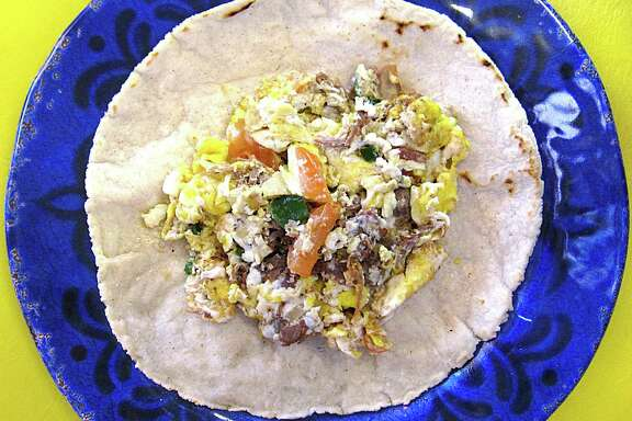 Machacado taco with eggs and pico de gallo on a handmade corn tortilla from Los Beltran.