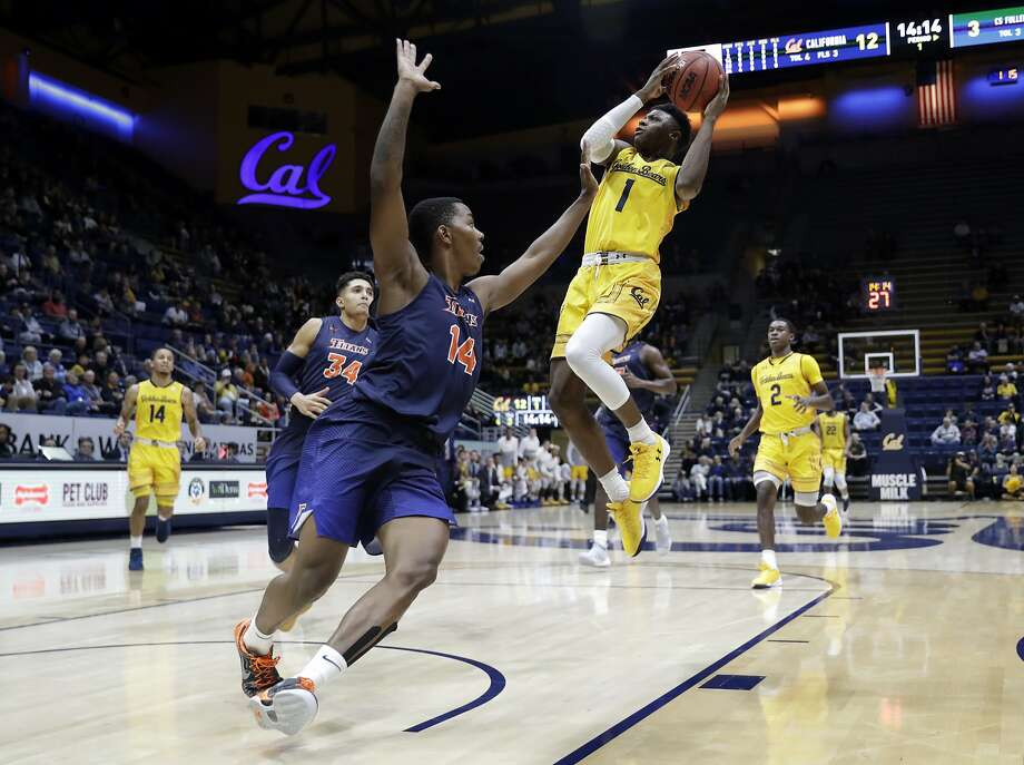 Cal guard Darius McNeill (1) shoots over Cal State Fullerton guard Khalil Ahmad (14) during the first half of a Bears 95-89 victory. Photo: Marcio Jose Sanchez, Associated Press