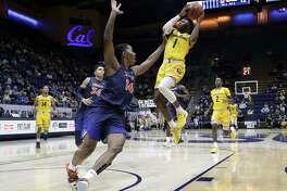 California guard Darius McNeill (1) shoots over Cal State Fullerton guard Khalil Ahmad (14) during the first half of an NCAA college basketball game Saturday, Dec. 16, 2017, in Berkeley, Calif. (AP Photo/Marcio Jose Sanchez)