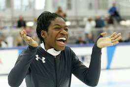Maame Biney reacts during a medal ceremony after winning women's 500-meter A final race during the U.S. Olympic short track speedskating trials Saturday, Dec. 16, 2017, in Kearns, Utah.