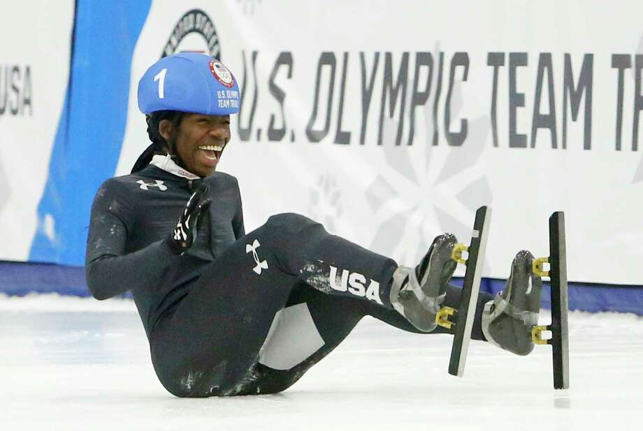 Maame Biney (1) falls as she reacts after winning women's 500-meter A final race during the U.S. Olympic short track speedskating trials Saturday, Dec. 16, 2017, in Kearns, Utah. Photo: Rick Bowmer, AP / Copyright 2017 The Associated Press. All rights reserved.