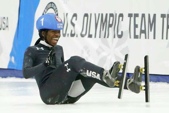 Maame Biney (1) falls as she reacts after winning women's 500-meter A final race during the U.S. Olympic short track speedskating trials Saturday, Dec. 16, 2017, in Kearns, Utah.