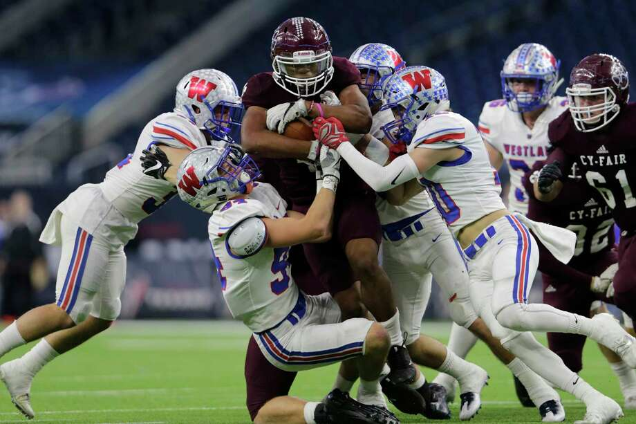 PHOTOS: Cy-Fair vs. Austin WestlakeCy-Fair Bobcats Trenton Kennedy (C) (43) rushes for a first down and is wrapped up by a gang of Austin Westlake Chaparrals defenders during the high school football semifinal playoff playoff game between the Austin Westlake Chaparrals and the Cy-Fair Bobcats at NRG Stadium in Houston, TX on Saturday, December 16, 2017. Photo: For The Chronicle / Houston Chronicle