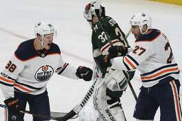 Edmonton Oilers' Jesse Puljujarvi (98) celebrates with teammate Milan Lucic (27) after Puljujarvi scored a goal in the third period of an NHL hockey game against the Minnesota Wild, Saturday, Dec. 16, 2017, in St. Paul, Minn. The Oilers won 3-2. (AP Photo/Stacy Bengs)