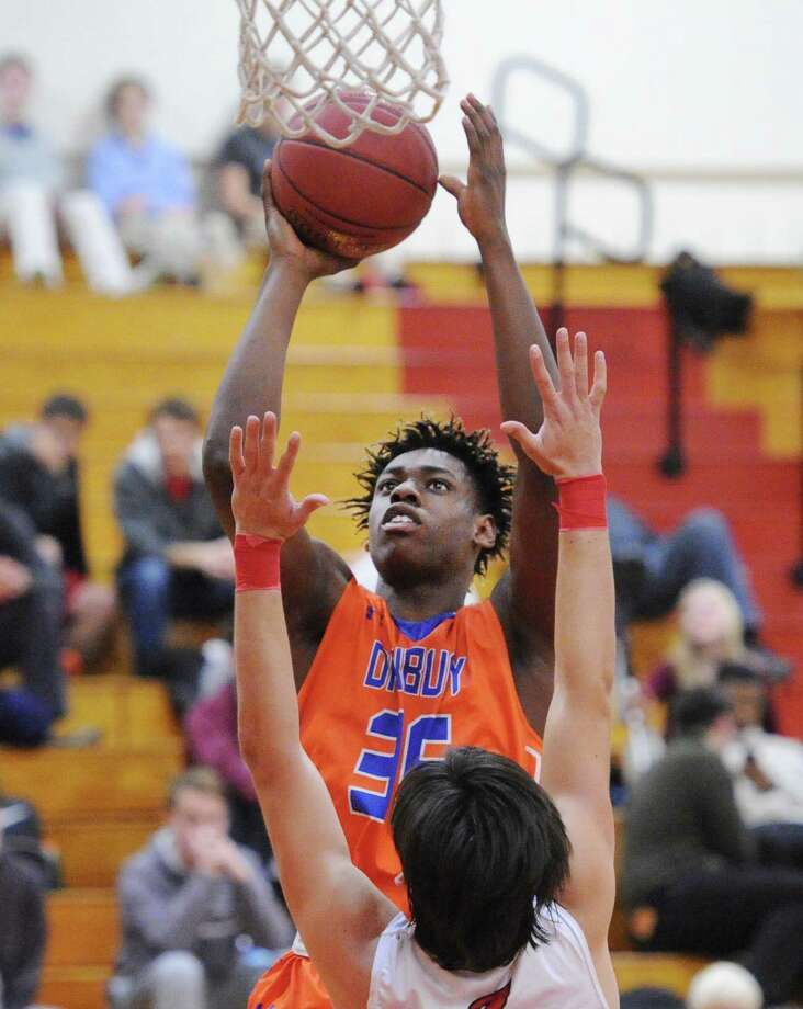 Danbury's Denali Burton (35) scores over Connor Langan (10) of Greenwich during the boys high school basketball game between Greenwich High School and Danbury High School at Greenwich, Conn., Wednesday night, Feb. 15, 2017. Photo: Bob Luckey Jr. / Hearst Connecticut Media / Greenwich Time