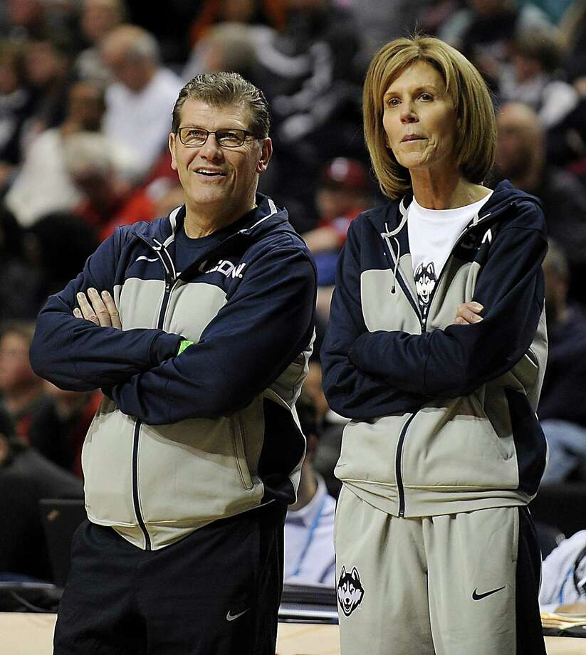 UConn head coach Geno Auriemma, left, and associate head coach Chris Dailey, seen here at the women's Final Four in 2014, can win their 1,000th game with the Huskies on Tuesday against Oklahoma. Photo: John Woike / Hartford Courant / Hartford Courant