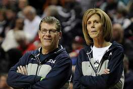 UConn head coach Geno Auriemma, left, and associate head coach Chris Dailey, seen here at the women's Final Four in 2014, can win their 1,000th game with the Huskies on Tuesday against Oklahoma.