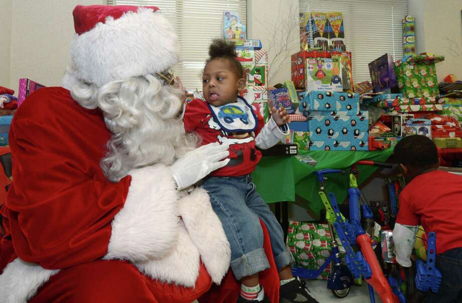 Santa Claus portrayed by James Dupree greets Kaleb Broodie, 3, as the DDH Hope Foundation Inc. holds their second annual Fund A Family event for families or children in need of Christmas celebratory items Saturday, December 16, 2017, in the Norwalk Police Department Community Room in Norwalk, Conn. Photo: Erik Trautmann / Hearst Connecticut Media / Connecticut Post