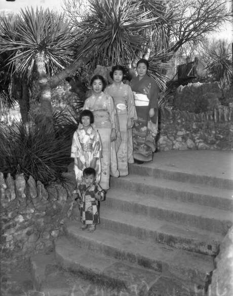The Jingu family — Kimi Jr. (left), Lillian, Rae, Ruth and their mother, Miyoshi — wear traditional dress. The Jingus served as live-in caretakers of the Japanese Tea Garden in Brackenridge Park. Shown here in 1937, the Jingus spent more than 20 years tending the gardens and operating a popular restaurant there before losing the lease on the city property in 1942. Photo: Courtesy Photo