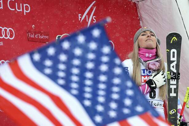 United States' Lindsey Vonn celebrates her firs place on the podium of an alpine ski, women's World Cup super-G, in Val d'Isere, France, Saturday, Dec. 16, 2017. (AP Photo/Marco Tacca)